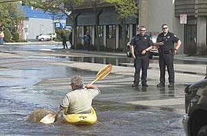 Wink Jones of High Performance Diamonds Kayaking down Main Street