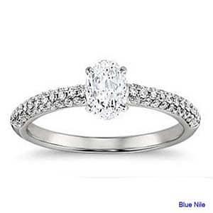 Three row pave set diamond engagement ring with oval brilliant cut diamond