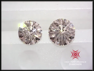 Crafted by Infinity diamond reviews, video comparison of one carat round to 1.442 carat round diamond