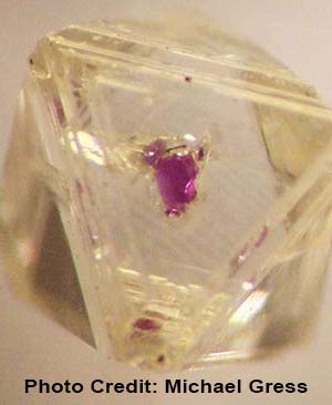 Age of Diamond, octahedral P-type rough from Venetia mine, South Africa, garnet mineral inclusion, photo credit Michael Gress