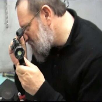 Fifth generation diamond cutter Brian Gavin examining a diamond between turns on the polishing wheel.