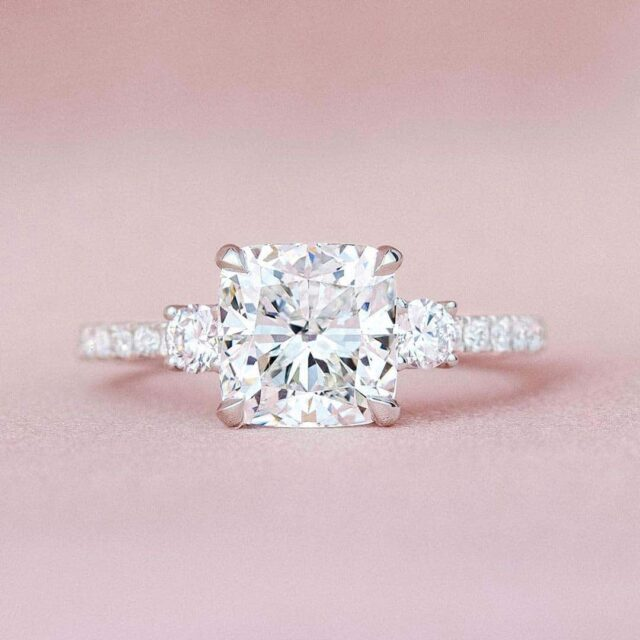 Brilliant Earth Cushion and Round 3-stone Engagement Ring.