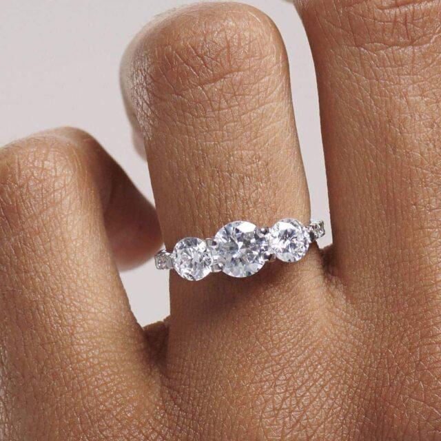 GIA vs AGS diamond grading 3-stone ring by Blue Nile.