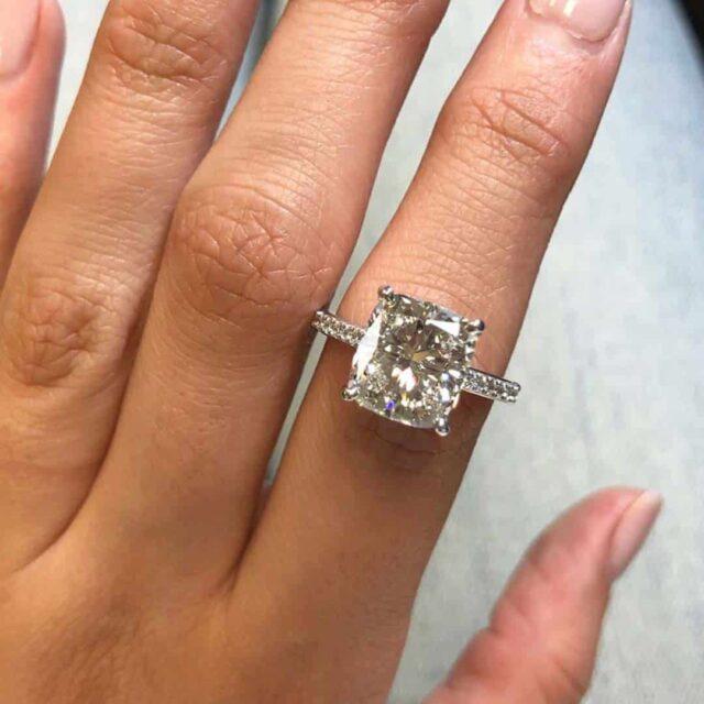 Ritani 4.2 carat cushion cut diamond in French setting.