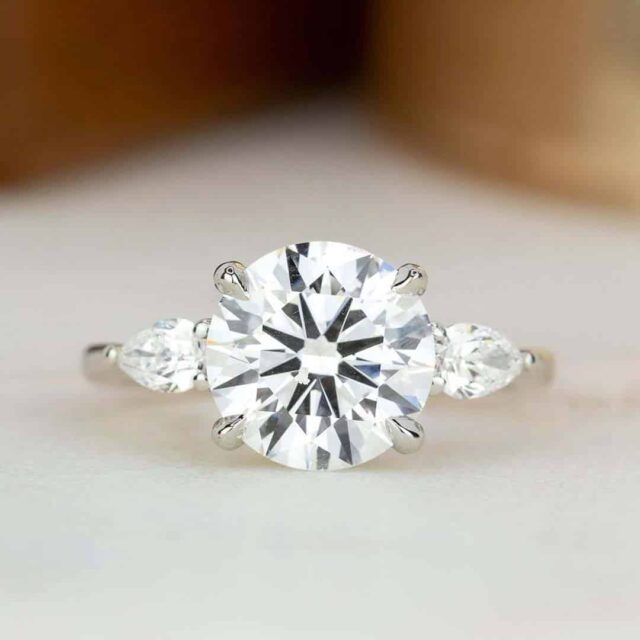 Round Brilliant Earth Diamond 3-stone Ring with Pear-shaped accents.