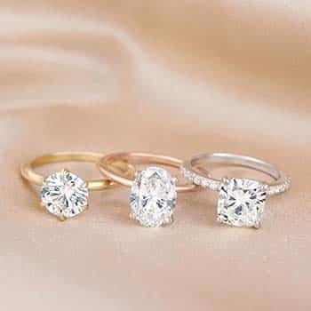 Round and Oval Solitaire and Cushion Pave Setting from Brilliant Earth.
