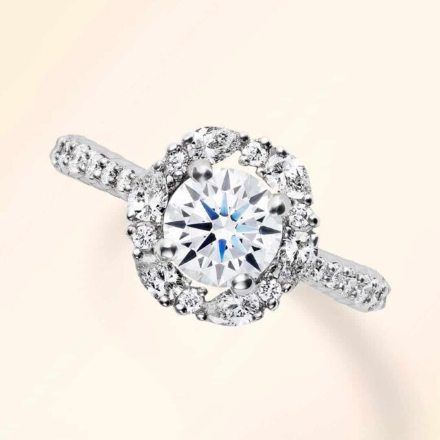 Round diamond and marquise halo setting by Blue Nile.