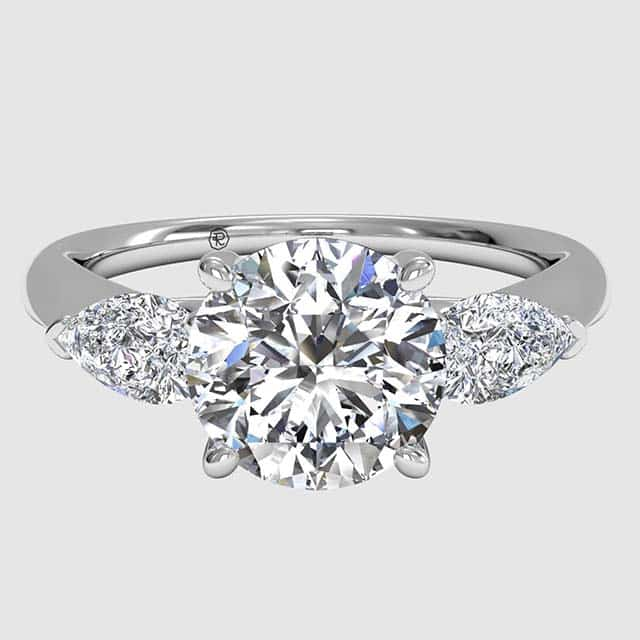 Pear-shaped accent and Round Engagement Ring by Ritani.