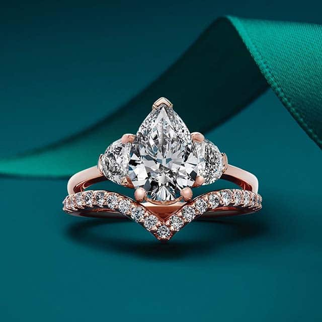 Three Stone Diamond Ring by Blue Nile with Pear Shaped Center and Half Moon Accents.