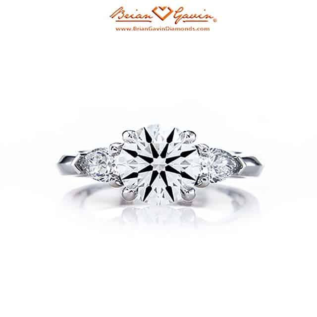 Summer Round and Pear-Shaped Three Stone Diamond Ring by Brian Gavin.