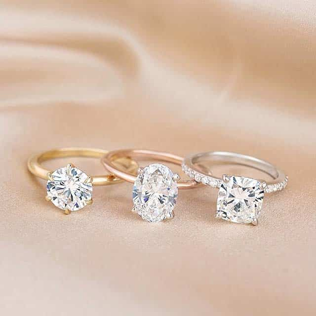 Yellow, Rose, and White Gold Brilliant Earth Diamond Solitaires.